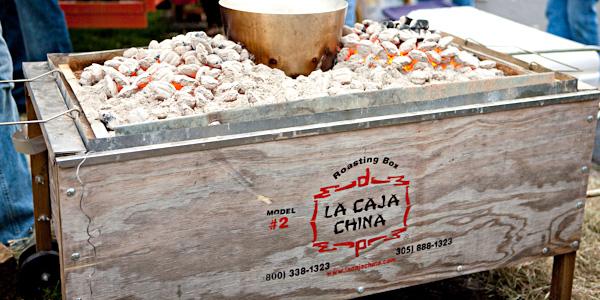 Image of a La Caja China Model 2 at a University of Texas game